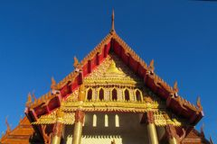 Buddhist Temple Wat in Thailand, thai traditional religious arcitecture. Buddhist Temple building with golden decoration, ornament and Buddha statues. Wat in stock images
