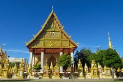 Buddhist Temple Wat in Thailand, thai traditional religious arcitecture. Buddhist Temple building with golden decoration, ornament and Buddha statues. Wat in royalty free stock photography