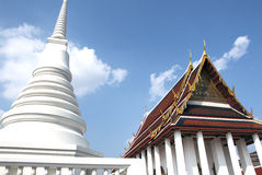 Buddhist Temple. White pagoda alongside the Buddhist Temple Stock Image