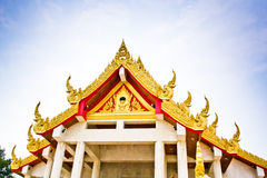 Buddhist temples. Details on Thai temple roof and sky Stock Photo