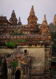 Buddhist temples in Bagan, Myanmar. An ancient Buddhist temple at sunrise in Bagan, Myanmar. Bagan is one of the world greatest archeological sites, a sight to Stock Photo
