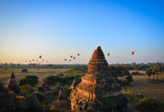 Buddhist temples in Bagan, Myanmar. Bagan, Myanmar - Feb 5, 2017. Buddhist temples with air balloons at sunrise in Bagan, Myanmar. Bagan is one of the world Stock Images
