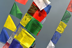 Buddhist Tibetan prayer flags blowing in the wind Stock Photography
