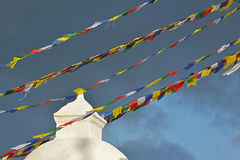 Buddhist Tibetan prayer flags blowing in the wind Stock Images