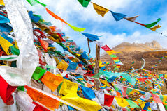 Buddhist tibetan prayer flags waving in the wind against blue sk Royalty Free Stock Image