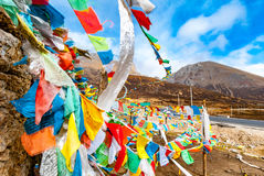 Buddhist tibetan prayer flags waving in the wind against blue sk. Y Stock Images