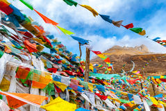 Buddhist tibetan prayer flags waving in the wind against blue sk Stock Photography