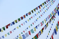 Buddhist tibetan prayer flags waving in the wind against blue sk Royalty Free Stock Photos
