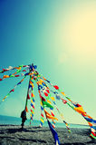 Buddhist tibetan prayer flags. Waving in the wind against blue sky Royalty Free Stock Photo