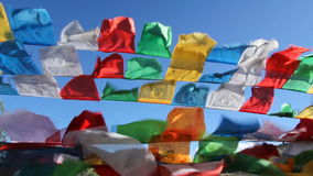Buddhist tibetan prayer flags waving in the wind ,,China