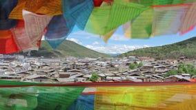 Buddhist tibetan prayer flags waving in the wind stock footage