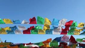 Buddhist tibetan prayer flags waving in the wind stock video footage