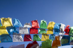 Buddhist tibetan prayer flags in the wind Stock Images