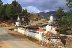 Buddhist wall on the road in, Bhutan Stock Photos