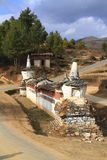 Buddhist wall on the road in, Bhutan Royalty Free Stock Photo