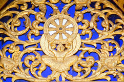Buddhist Wheel decoration. Glass and gilt decoration at Wat Phrathat Doi Suthep showing the Buddhist wheel held up by Garuda Royalty Free Stock Photos