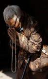 Buddhist Woman. Buddhist Pilgrim Praying at Boudhanath Stupa, Kathmandu, Nepal Stock Photos