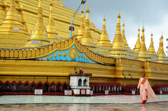 Buddhist woman ascetic or nun walking at Shwemawdaw Paya Pagoda in Bago, Myanmar. Royalty Free Stock Photo