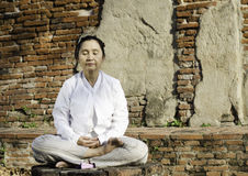 Buddhist woman in meditation Royalty Free Stock Image