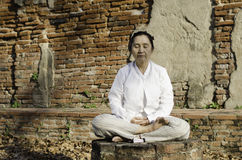 Buddhist woman meditating Royalty Free Stock Images
