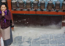 Buddhist Woman and Prayer Wheels Royalty Free Stock Photos