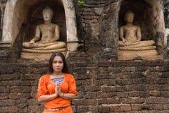 Buddhist woman praying Stock Photo