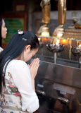 Buddhist woman praying on eve Royalty Free Stock Image