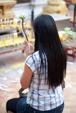 Buddhist woman praying on eve Royalty Free Stock Photos
