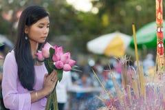 Buddhist woman praying at temple Royalty Free Stock Photos