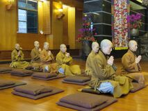 Buddhist women praying