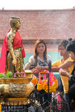 Buddhist worshiping and making religious merit. KORAT, THAILAND - JANUARY 16 : The unidentified Buddhists are worshiping Thao Suranari statue and making stock photos