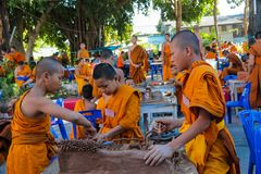 Buddhist young monks doing handcrafts in the temple yard. Buddhist monk doing handcrafts in the temple yard. Young Buddhist monks in a Buddhist monastery in stock images