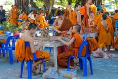 Buddhist young monks doing handcrafts in the temple yard. Buddhist monk doing handcrafts in the temple yard. Young Buddhist monks in a Buddhist monastery in royalty free stock image