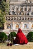 Buddhistic monk prayer. Buddhistic monk. Mahabodhy Temple in Bodhgaya, Bihar, India Stock Photo