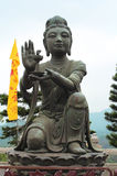 Buddhistic statue making offering to the Big Buddha, Hong Kong Stock Photos