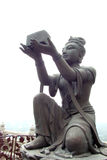 Buddhistic statues praising Royalty Free Stock Image