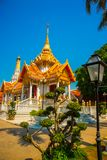 Buddhistic temple.Beautiful religious building is white with gilding. Ayutthaya. Thailand. Royalty Free Stock Images