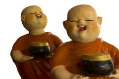Buddhistische Anfängerpuppe lokalisiert auf weißem Hintergrund stockfotos
