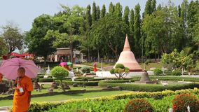 Buddhists on excursion in Mini Siam park in Pattaya, Thailand stock video