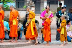 Buddhists give food to monks for merit time Royalty Free Stock Image