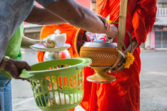 Buddhists have faith in Buddhism. giving alms to monks receive a Royalty Free Stock Photos