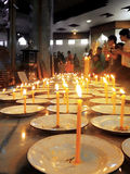 Buddhists lighting candles Stock Photo
