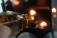 Oil fill in a lamp for lighting and for use in incense. Stock Photos