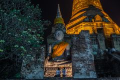 Buddhists people motion blur with lighted candles in ancient temple stock images