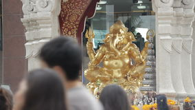Buddhists praying in front of Ganesh monument, Bangkok Stock Photos