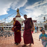 Buddhits monks and pilgrims at kora around Boudhanath Stupa. Nepal, Kathmandu Stock Images