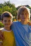 Buddies. Two smiling young brothers stand arm-in-arm as best buddies - for now Royalty Free Stock Photo