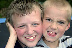 Buddies 3. Portrait of two boys, one smiling, one making a silly face stock photo
