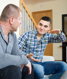 Buddies chatting in home interior Royalty Free Stock Photo