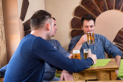 Buddies are having beer. In pub Stock Photo